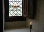 vitrail géométrique avec rondel style XVème.