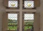 vitrerie 15ème siècle avec copies rondels